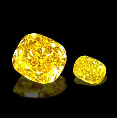 The 101.28-carat Golden Star diamond and its 16.63-carat satellite sister diamond, both cushion-cut and fancy vivid yellow