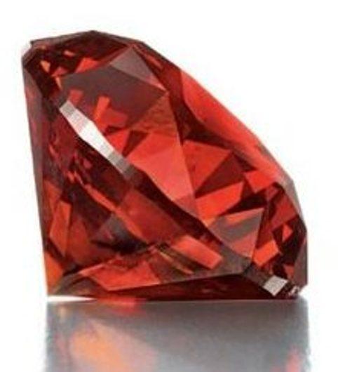 Side view of 3.15-carat, round brilliant-cut, fancy reddish-orange diamo