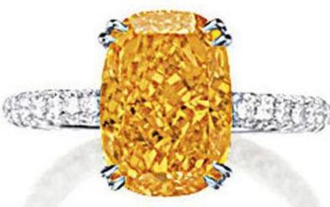 4.19-carat, cushion-cut, fancy vivid orange diamond set on a 18k white-gold ring