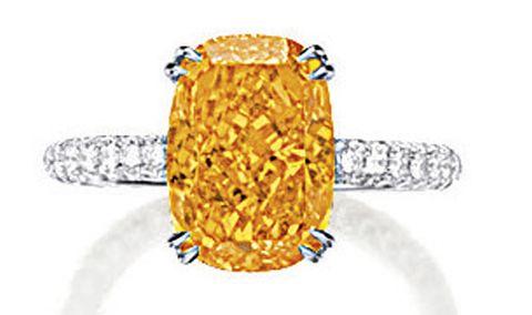 4.19-carat, cushion-cut, fancy vivid orange diamond set in a ring