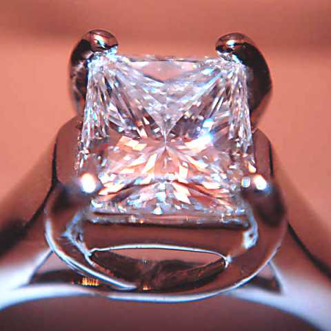 A princess cut diamond set in an engagement ring