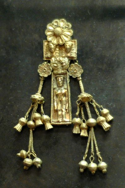 Ancient Greek jewelry- Pendant with naked woman made of electrum, Rhodes- 620 B.C.