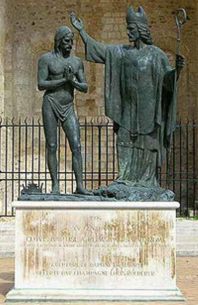 Statute in the Cathedral of Reims showing baptism of Clovis by Saint Remi in 496 A.D.