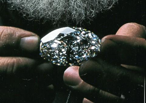 Beluga Diamond being held by one of the workers of William Goldberg Diamond Corporation
