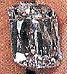 Close-up of Ashoka-cut satellite diamond