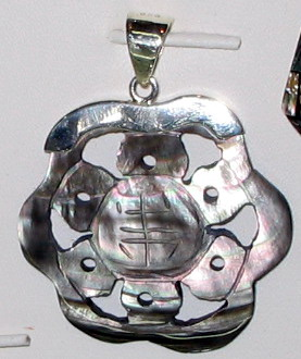 A Carved Abalone Eardrop