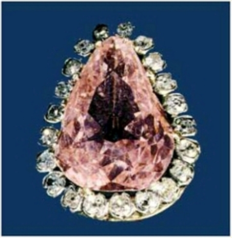 Pear-shaped Conde Pink diamond in a setting surrounded by a row of smaller diamonds