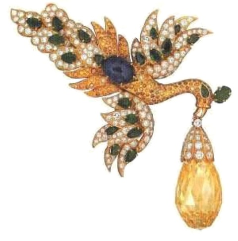 Fancy yellow Walska diamond set in a swan motif prndant clip