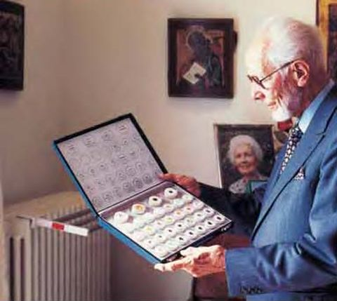 Dr. Gubelin, the pioneering Swiss gemologist looking at a set of gems from his personal collection