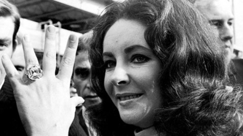 Elizabeth Taylor showing off the Krupp diamond ring, a piece of jewelry towards which she developed a strong personal attachment and became closely identified with her personality