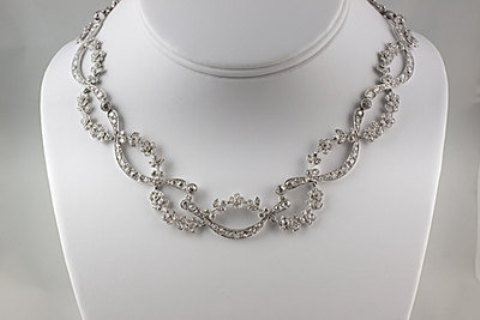 G10605 - Open work floral link design diamond and platinum necklace