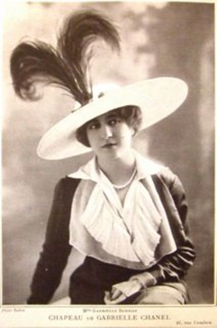 Gabrielle Coco Chanel wearing one of her hats in 1912