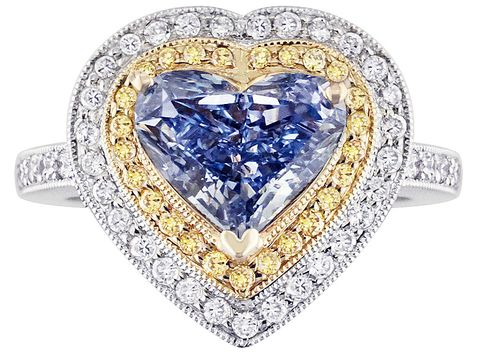Heart-shaped, white-gold, cluster ring set with the Lady Diantha Blue Diamond as centerpiece