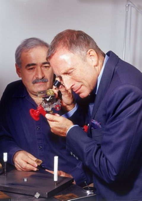 Laurence Graff inspecting the Golden Star Diamond while the late master cutter Nino Bianco looks on