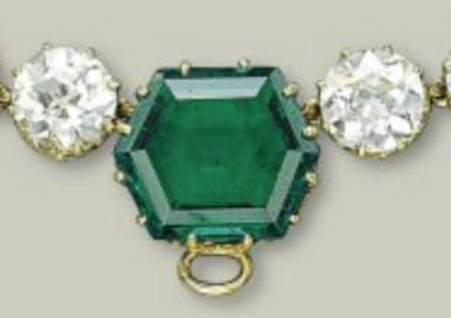 The central large hexagonal emerald with a loop for the Andean Cross