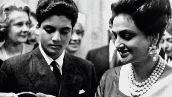 Maharani Sita Devi with her son Princie at the Van Cleef & Arpels party in 1960 admiring the necklace incorporating the Princie Diamond, that was named in her son's honour