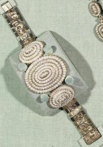 Close-up of a seed pearl bracelet, one of two identical bracelets in the suite