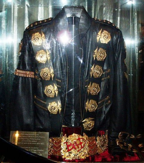 "Michael Jackson's original Jacket and Belt worn in the music video ""Bad"". The jacket and belt are emblazoned with 12 pounds of 24-karat gold and crystal decorations."