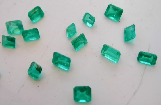 Well-saturated, vivid green Muzo emeralds with a slightly yellowish undertone