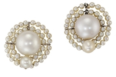Pair of natural pearl earrings with a circular design