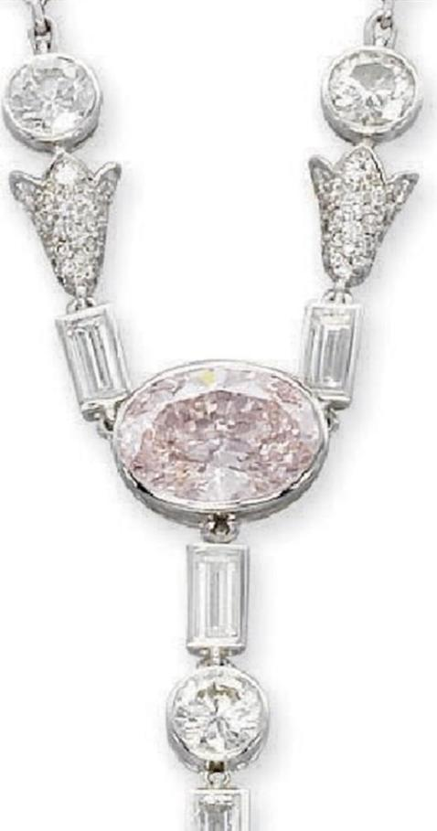 Cartiers natural pearl white and pink diamond necklace the centerpiece of the necklace the old circular cut pink diamond from which arise aloadofball Images