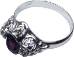 Ring of unique design with a Ceylon (Sri Lankan) violet sapphire and diamonds set in white gold.