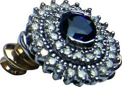 Cluster ring with a large Ceylon blue sapphire and two concentric rows of diamonds set in 18k gold.