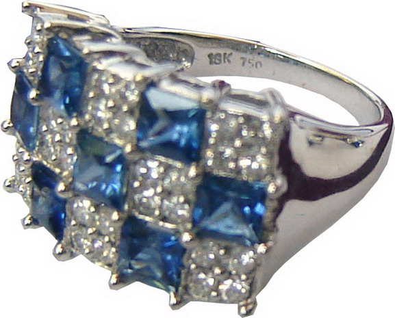 Rectangular ring with three rows lengthwise and five rows breadthwise,consisting of alternating blue sapphires and diamonds.