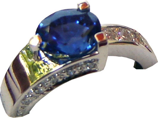 Ring of unique design with a Ceylon (Sri Lanka) blue sapphire and diamonds set in 18ct white gold.
