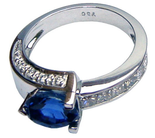 Ring of unique design with Ceylon (Sri Lanka)blue sapphire and diamonds set in white gold.