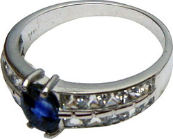 Ring of unique design with large Ceylon blue sapphire and white sapphires set in 18ct white gold.