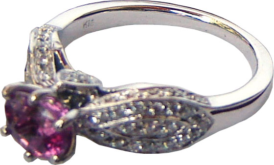 Ring of unique design with a large Ceylon(Sri Lanka) Pink Sapphire and diamonds set in 18 ct white gold.