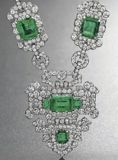 Shield-shaped emerald and diamond pendant
