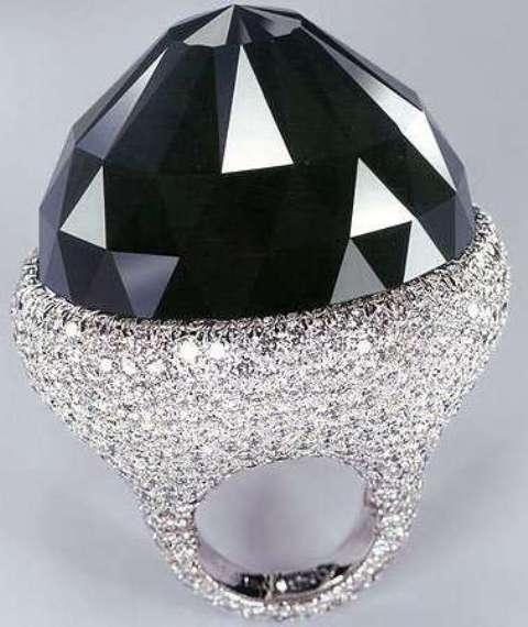 Spirit of de Grisogono black diamond on its white gold mounting set with white diamonds