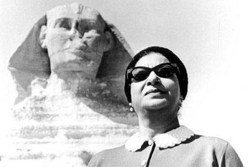 Umm Kulthum standing opposite the Sphinx in Egypt