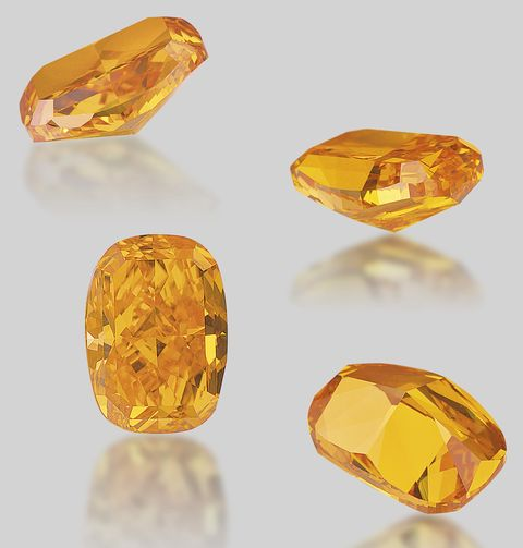 Various views of the unmounted 4.19-carat, fancy vivid orange diamond