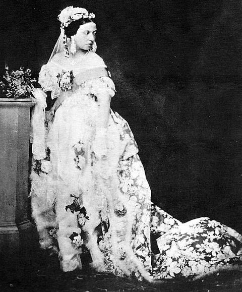 Queen Victoria photographed in her wedding gown around 1854