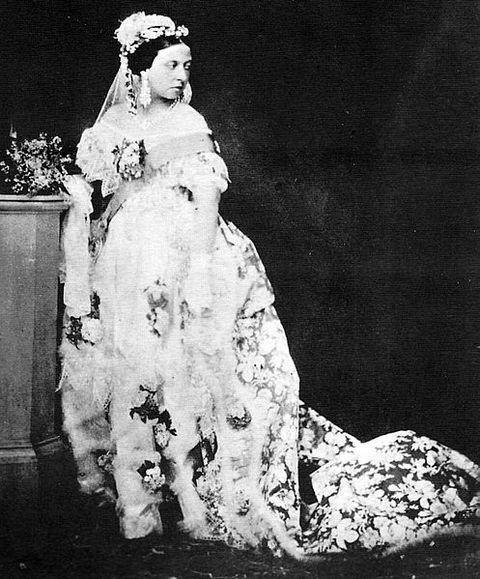 Queen Victoria photographed in her wedding gown around 1854