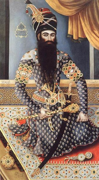 Fath Ali Shah- seated on a jewel-studded carpet