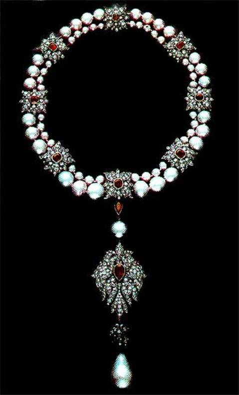 La Peregrina pearl mounted as pendant on a pearl, ruby and diamond necklace designed by Cartier in 1969